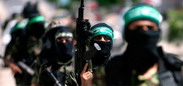 Hamas terrorists such as these are allegedly receiving support and funding from World Vision, Save the Children and possibly other international aide groups, according to Israeli intelligence.