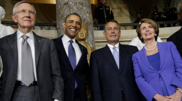 Former U.S. House Speaker John Boehner, R-Ohio, (center right) stands with then-President Obama; Rep. Nancy Pelosi, D-Calif.; and Sen. Harry Reid, D-Nev.