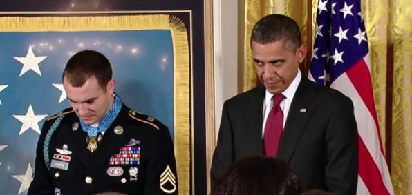 President Obama is seen raising his eyes with his head partially bowed during the chaplain's closing prayer in a Medal of Honor ceremony for Staff Sgt. Salvatore Giunta on Nov. 16, 2010