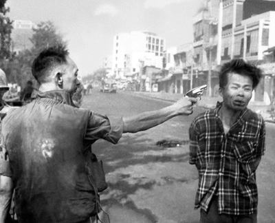 South Vietnamese police chief Nguyen Ngoc Loan executes a Viet Cong guerrilla on Feb. 1, 1968