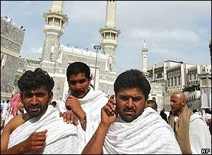 Men on the Hajj wear the customary white towels.