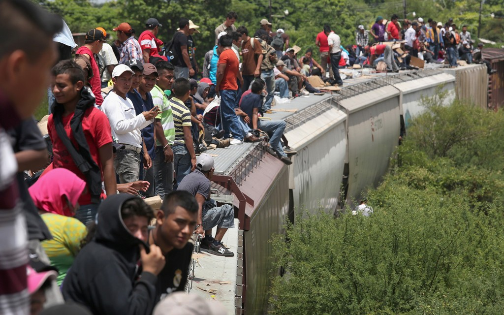 Central American migrants ride the trains through Mexico to the United States .