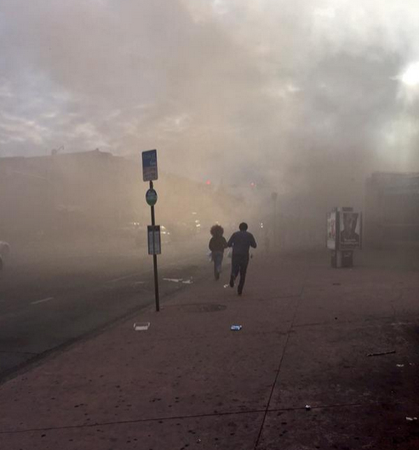 Smoke fills the streets in Baltimore as a CVS pharmacy burns