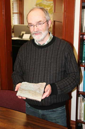 Dr. Lowe displays one of his geologic samples, which is said to be more than 3 billion years old (Photo by Anthony C. LoBaido)