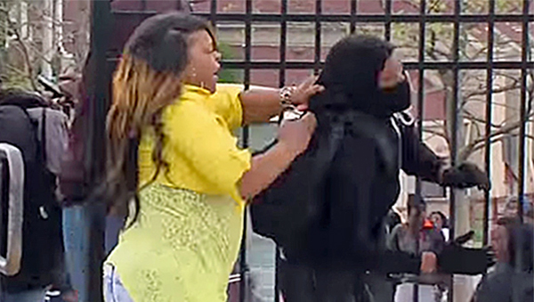 Baltimore mom Toya Graham catches her 16-year-old son as he attempts to throw a rock at police