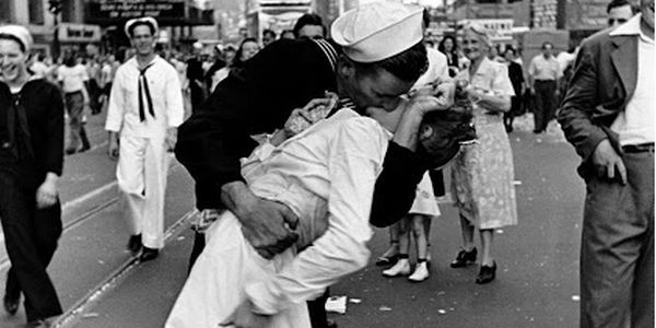Sailor kissing nurse on VE Day