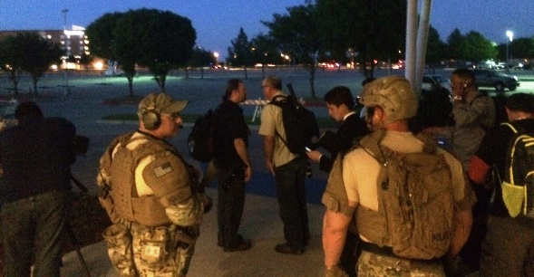 SWAT officers prepare to escort media to their cars in Garland, Texas, Sunday night after an officer was shot at a Muhammad art event (WND photo)