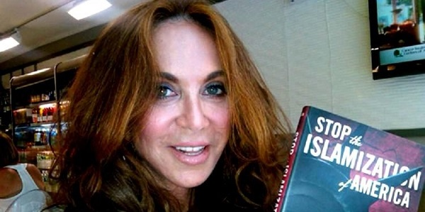 geller_with_book_600x300