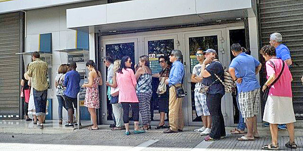 Greek citizens rush to banks to try to withdraw cash.