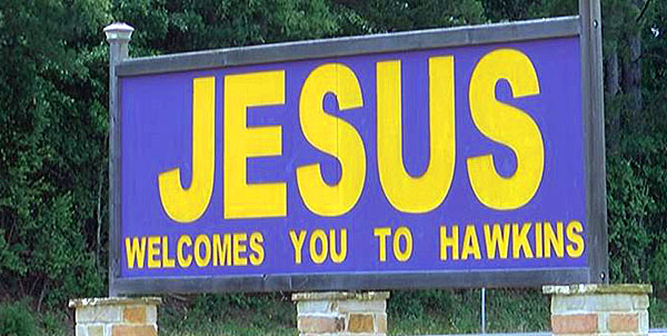 "The Texas sign declaring ""Jesus welcomes you to Hawkins"""