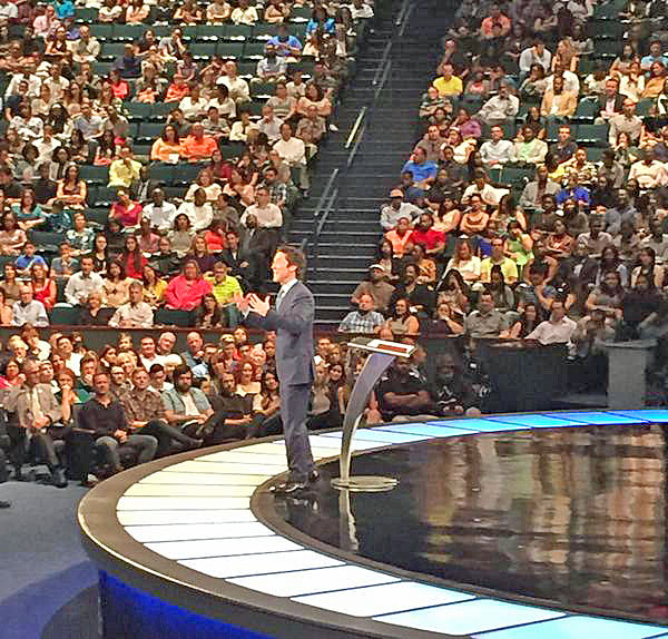 Pastor Joel Osteen gets heckled at his Houston church June 28, 2015.