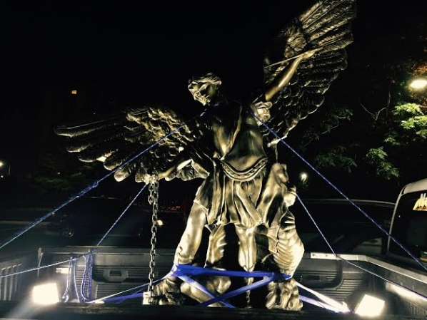 The 6-foot tall bronze statue of Archangel Michael was brought in to counter the influence of Satan.