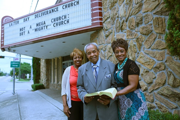 Bishop Kossie with his daughters at the Latter Day Deliverance Center Church in Houston's fifth ward.