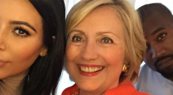 While the GOP debate captivated America, Democrat front-runner Hillary Clinton spent the evening at a fundraiser with Kim Kardashian (left) and rapper Kanye West (right) in Los Angeles