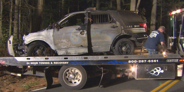 A police SUV burst into flames after hitting a tree (WBZ-TV)