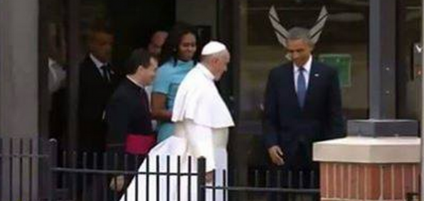 Obama's head is framed with what seems to be horns.