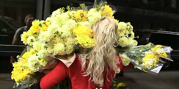 Stephanie Mercades attempts to deliver hundreds of flowers to protest Donald Trump's immigration stance. (images: TMZ)