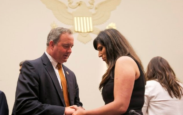 Rep. Jeff Duncan prays with Haghmeh Abedini at the Capitol.