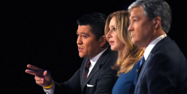 Debate moderators Carl Quintanilla, left, Becky Quick, center, and John Harwood appear during the CNBC Republican presidential debate at the University of Colorado (Fox News)