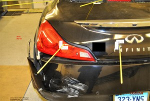 Bullet holes in rear of Carey's car (Photo provided by Department of Justice)