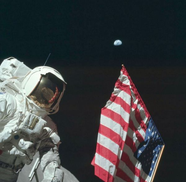 I Can't See My House From Here Apollo 17 astronaut Harrison Schmitt, the only Apollo astronaut who was also a professional scientist, stands next to the U.S. flag with Earth in the background. PHOTOGRAPH BY NASA