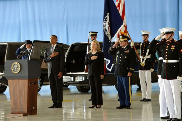 President Obama and Secretary Clinton at the Transfer of Remains Ceremony for victims of the Benghazi attack held at Andrews Air Force Base on Sept. 14, 2012 (Licensed under Public Domain via Commons)