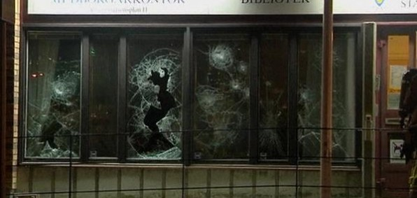 Bookstore in Stockholm suburb had its windows smashed by rock-throwing immigrants. Cars were torched and buildings burned but a media blackout is in place in the U.S., which plans to step up its own importation of Muslim refugees under President Barack Obama's recently announced plan.