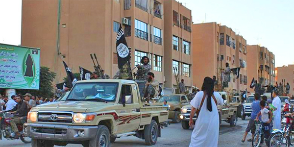 An image by jihadist website Welayat Raqqa allegedly shows ISIS militants parading in ISIS stronghold of Raqqa, Syria