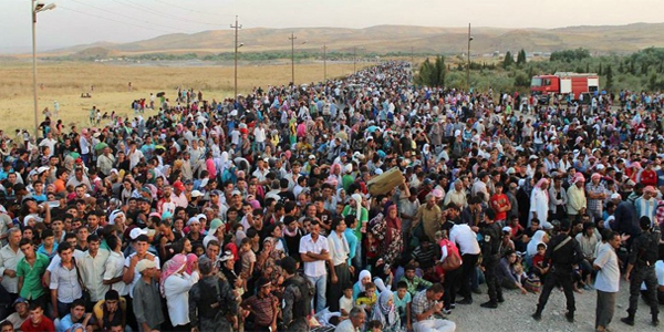 Thousands of Syrians flood across the border into Iraq (Photo: United Nations High Commissioner for Refugees)