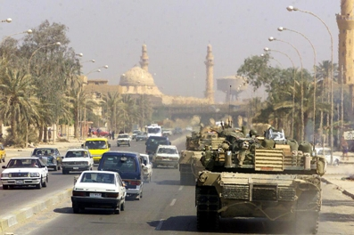 A Marine Corps M1 Abrams tank patrols a Baghdad street in 2003 during Operation Iraqi Freedom. (Wikimedia Commons)