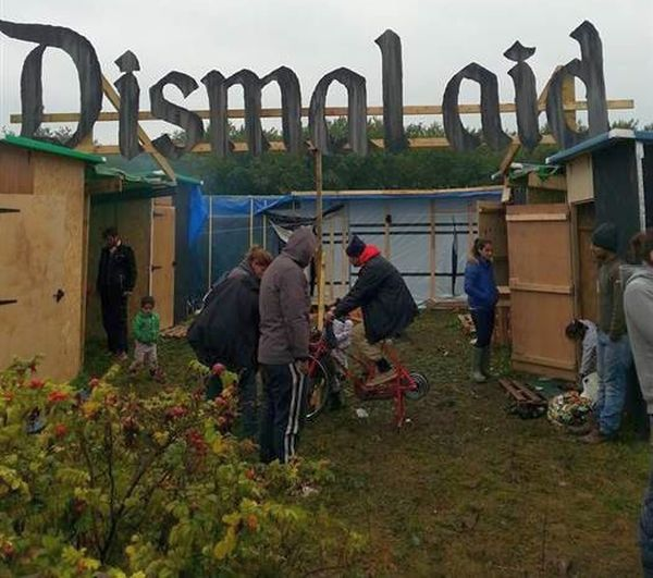 "Banksy's contributions to Calais Camp. Altered ""Dismaland"" sign – not appreciated by the non-natives. Photo by Lee McGrath / Lincolnshire Aid 2 Calais"