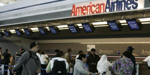 Passengers at an American Airlines terminal.