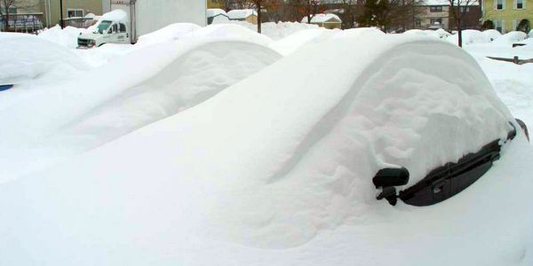Cars buried in snow