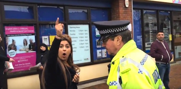 "A Muslim woman screams ""Muslims will take over!"" at Christian activists in Luton, England (Photo: YouTube, Britain First)"