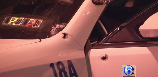 Bullets riddled the cruiser a policeman, who was shot at 13 times, drove in downtown Philadelphia. (Credit: Screen shot ABC News)