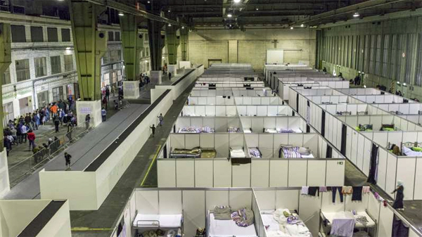 Asylum-seekers stay in temporary accommodation in one of three huge hangars at Berlin Tempelhof Airport in Germany (Photo: The U.N. High Commissioner for Refugees)