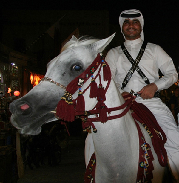 Tales of the Arabian Nights come to life on the Arabian Peninsula as this man riding on horseback proves at an evening bazaar (Photo: Anthony C. LoBaido)