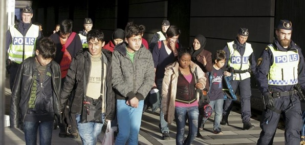 Migrants pour into Sweden, which has one of the most liberal immigration policies in the E.U.
