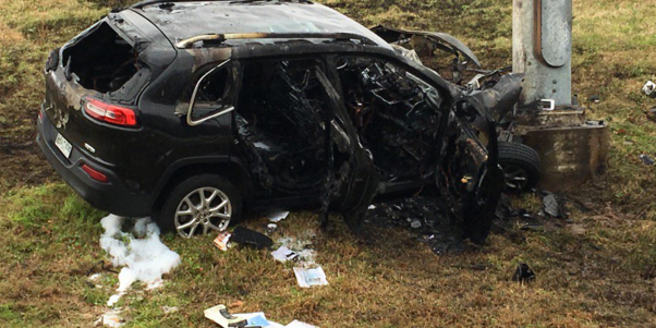 Emergency response officials pulled a driver, and a Bible, from this SUV that exploded into flames. (Credit: Twitter)