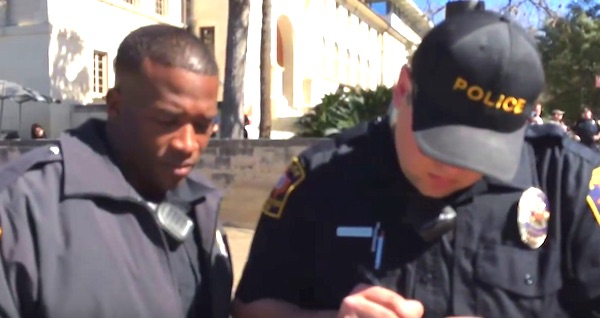 "A Texas cop issued a citation to a preacher for ""offending"" a University of Texas at Austin student"
