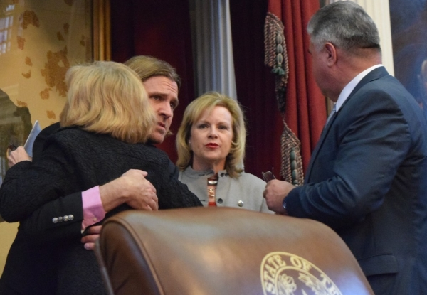 Dan Golvach gets hug from Rep. Debbie Riddle at the Texas State Capitol last year.