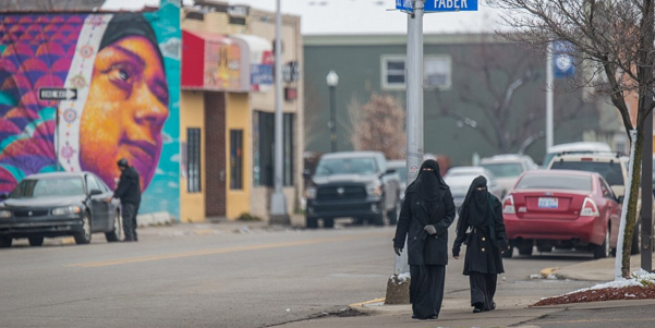 Two Muslim women walk down the streets of Hamtramck, Michigan, where the population used to be dominated by the Polish.