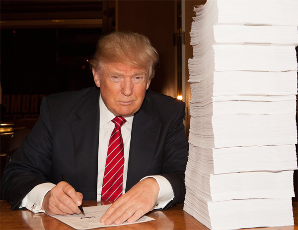 "GOP frontrunner Donald Trump shared this photo of himself signing ""a recent tax return"" (Photo: Twitter)"