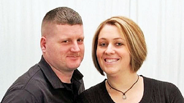 U.S. Marine veteran John Kevin Wood and his wife, Melissa