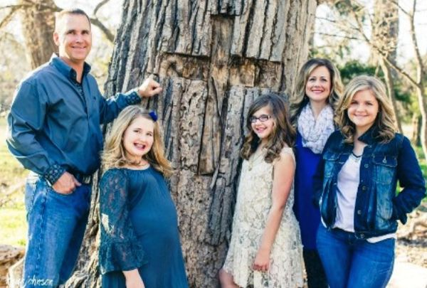The real-life Beam family and their cottonwood tree – with the cross