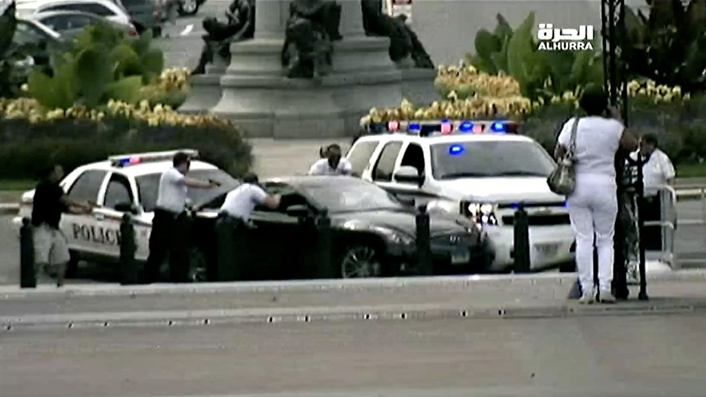 U.S. Capitol Police officers and Secret Service agents surround Miriam Carey's car at Garfield Circle on Oct. 3, 2013