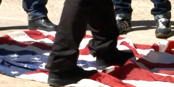 Activists in Milwaukee, Wisconsin stomp on the American flag at a Donald Trump rally on April 3, 2016 (Photo: WITI-6 screenshot)