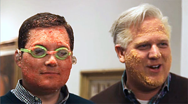 Radio host Glenn Beck and co-host smother faces in Cheetos to look like GOP front-runner Donald Trump (Photo: screenshot)