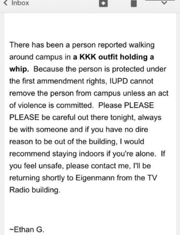 "Students at Indiana University were sent a warning about a member of the KKK ""holding a whip."" The so-called whip was really a rosary that belonging to a priest (Photo: The Tab screenshot)"