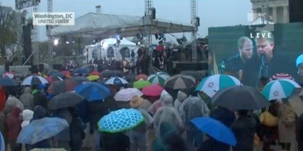 The event opened rain-drenched and freezing cold